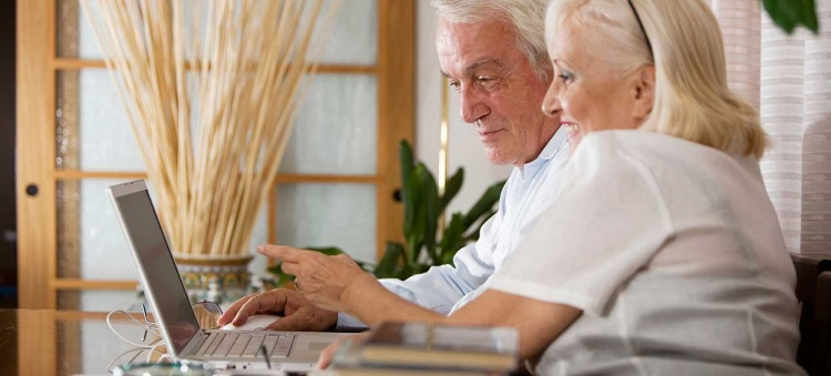 Senior couple with computer